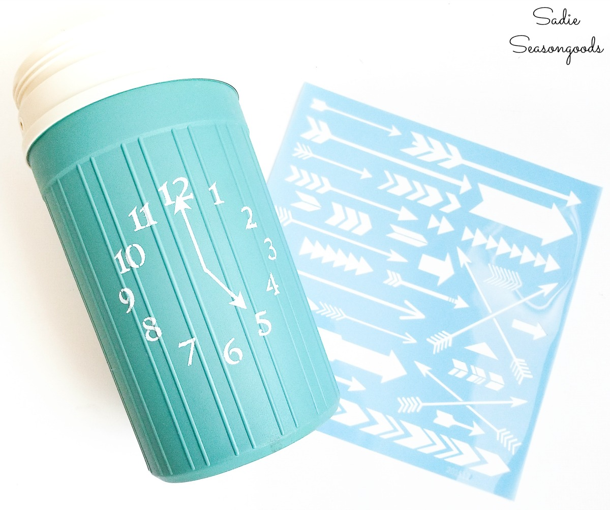 Wine cooler bucket with a clock stencil from an Igloo beverage cooler