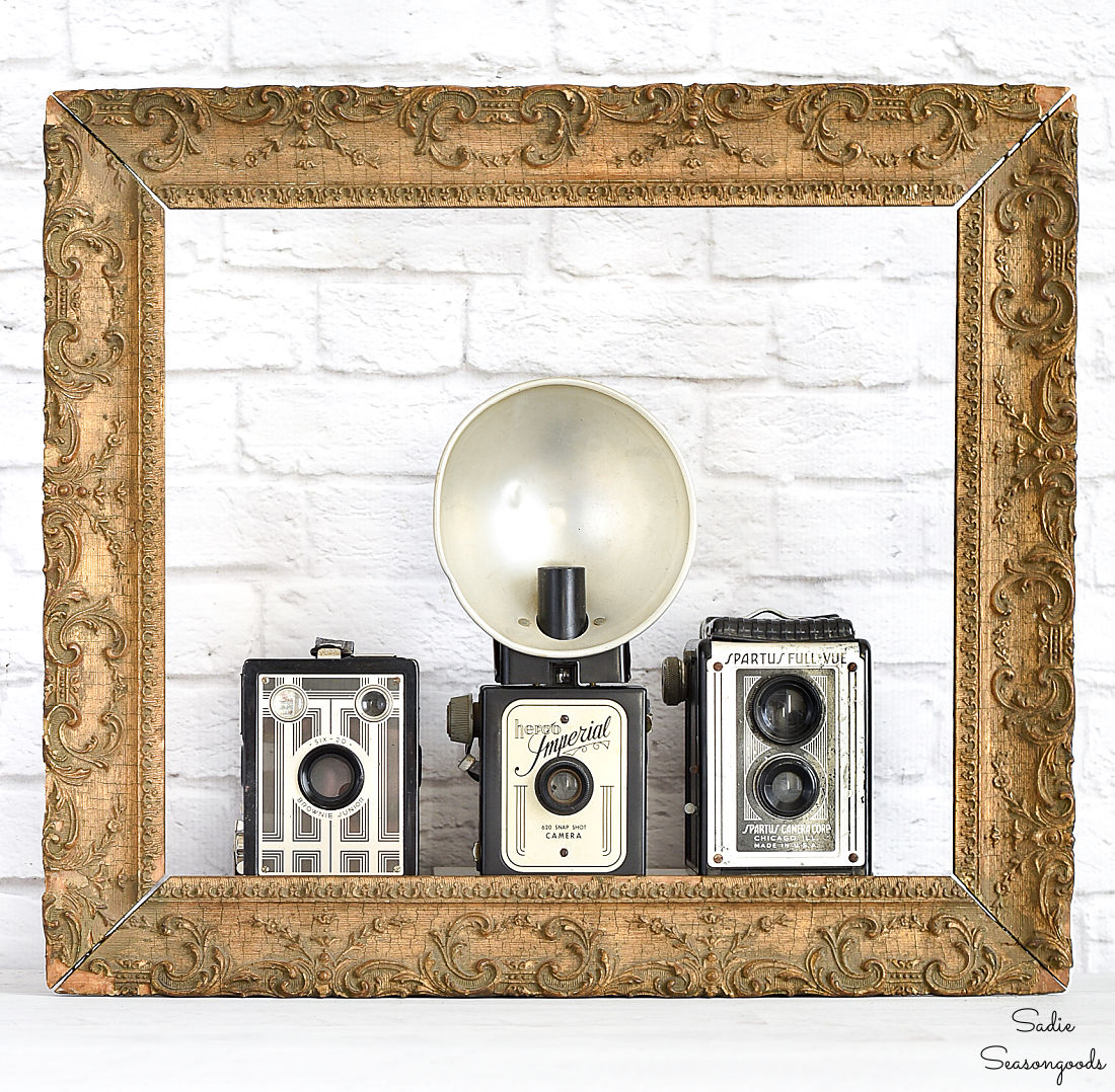 Gesso frame as a backdrop in a vintage vignette