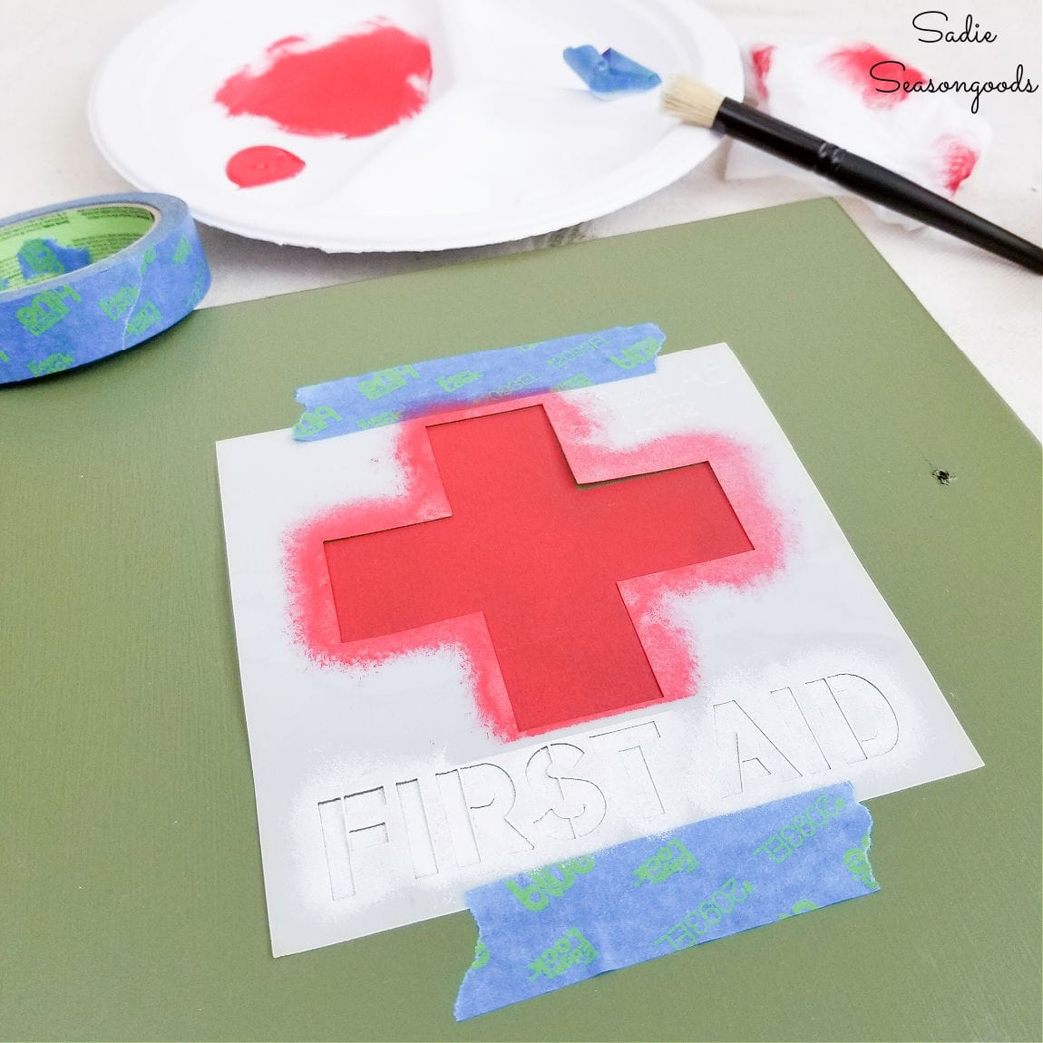 stenciling a first aid cabinet