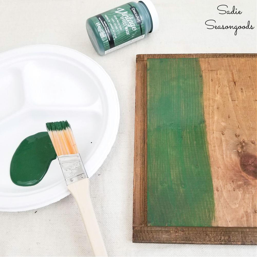 vintage effect wash on a wooden medicine cabinet