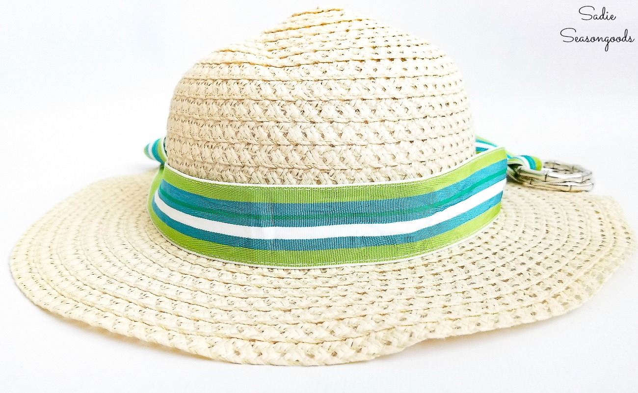 Using a ribbon belt to make a hat band on a sun hat from the thrift shop