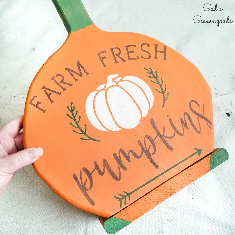 Pumpkin patch decor from a wood paper plate holder