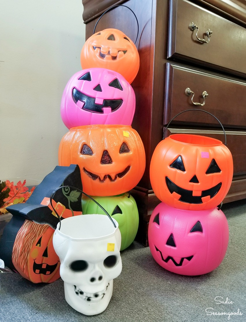 Plastic pumpkins at a thrift store