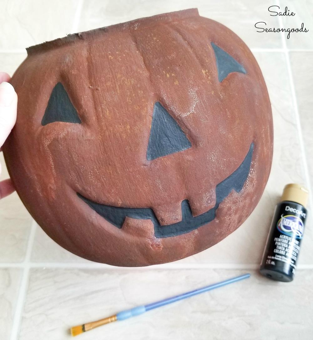 Rust effect paint on a Halloween candy bucket