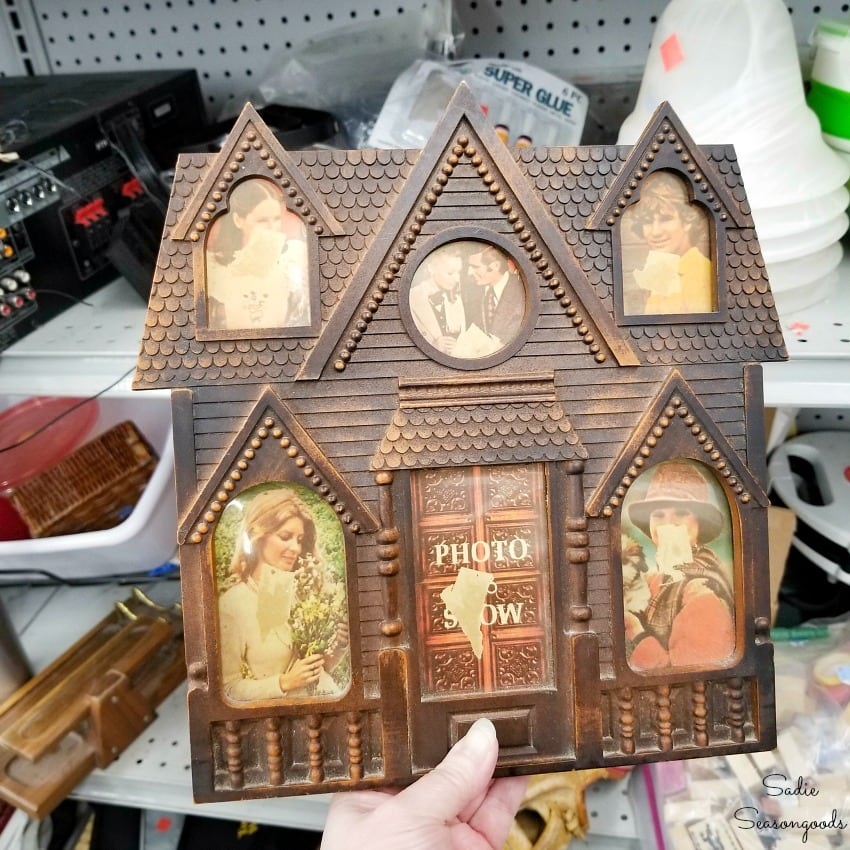 House shaped picture frame at a thrift store