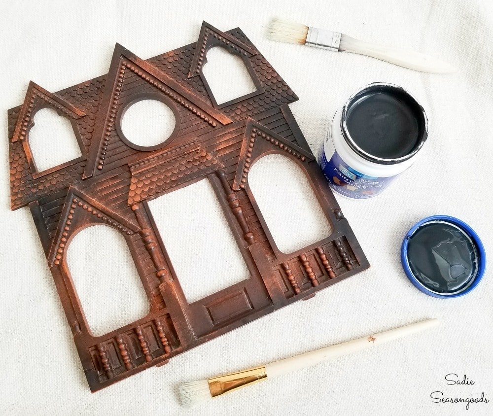Painting a house shaped picture frame with black paint