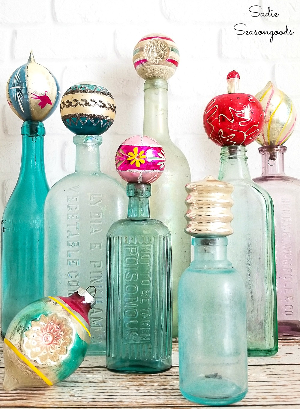 Retro Christmas Decorations with vintage Christmas ornaments on antique bottles
