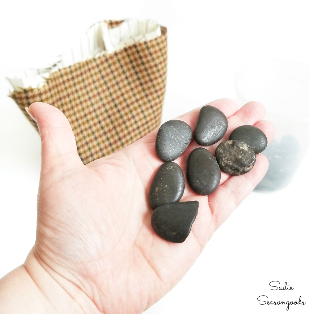 Rocks for weight and stability in the acorn decor
