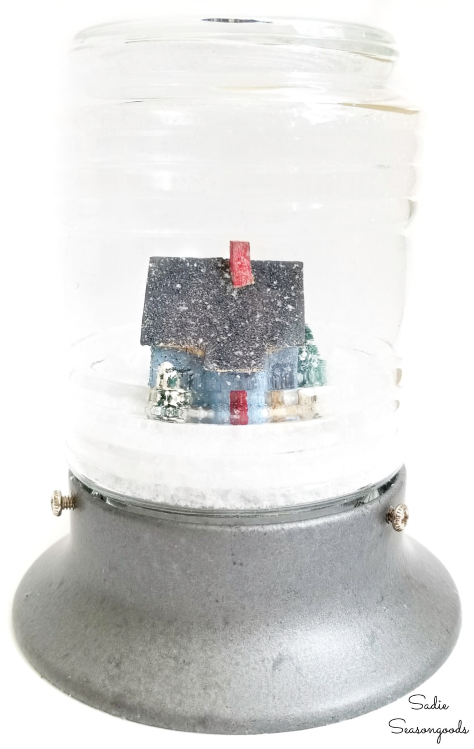 Winter snow globe with a vintage putz house