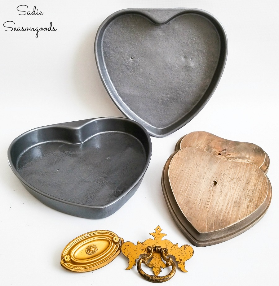 Assembling the heart decorations with cake pans and vintage drawer handles
