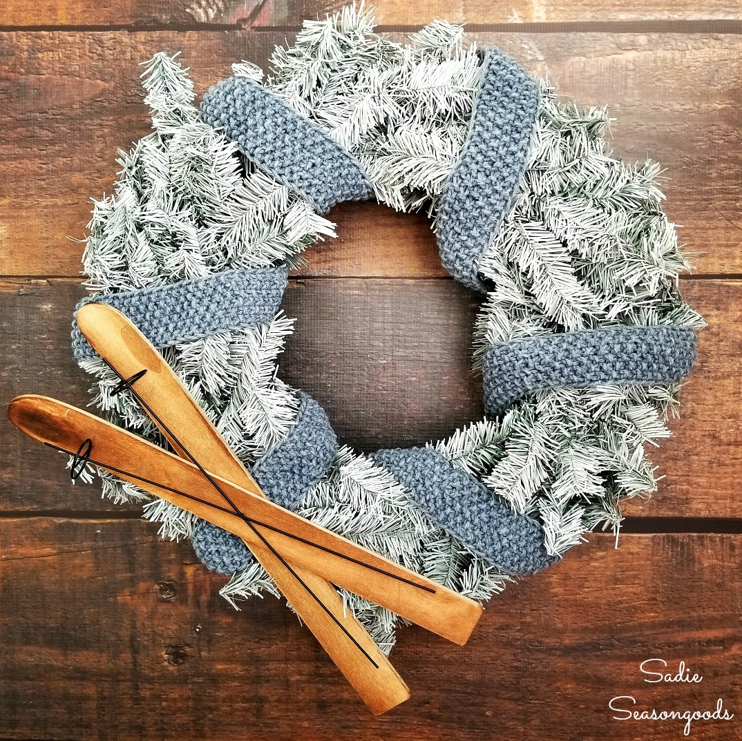 Flocking a Christmas wreath to be a winter wreath and using a skinny scarf as wreath ribbon