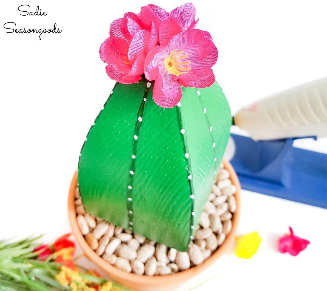 Adding flowers to DIY cactus decor