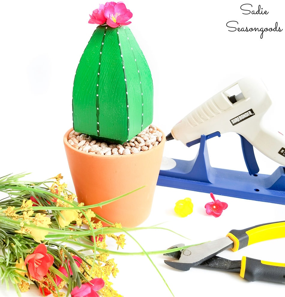 attaching the fake cactus flowers with hot glue
