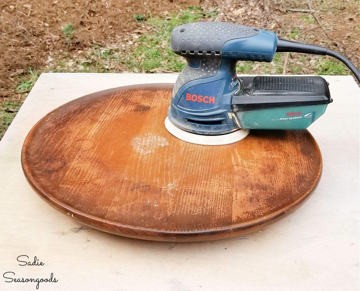 sanding a wooden lazy susan