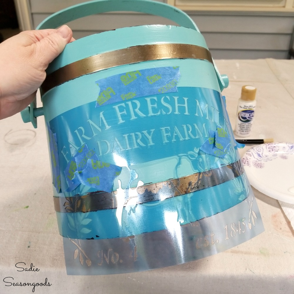 Farmhouse stencil on vintage ice bucket to become a flower bucket