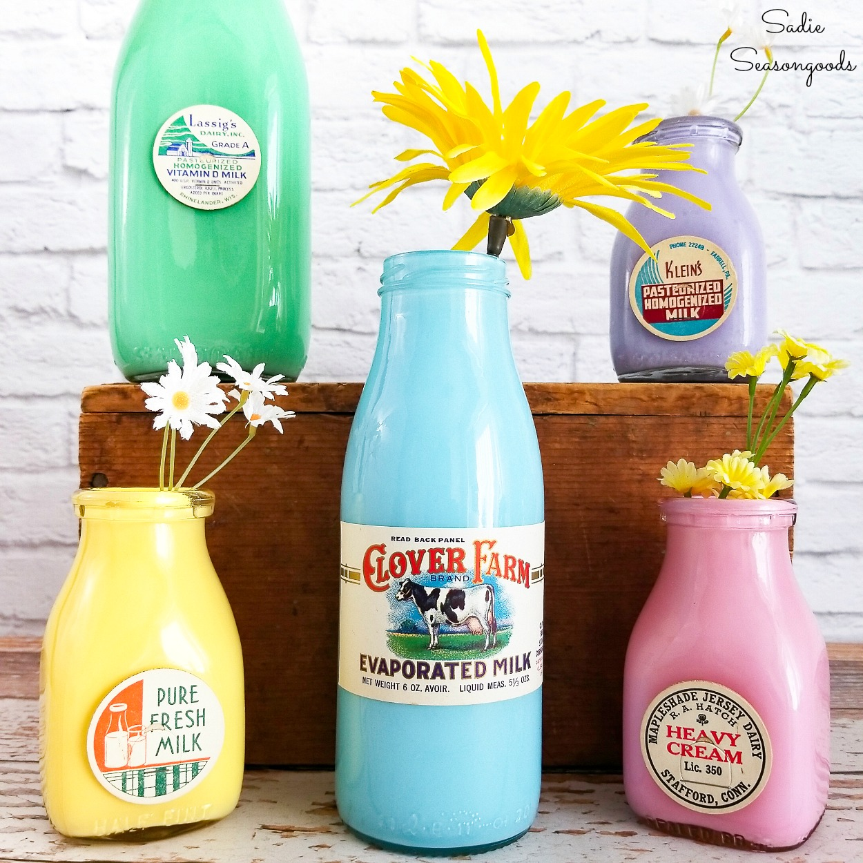 Milk tops on old glass milk bottles as flower vase ideas for Spring Decor