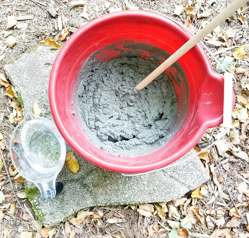 Mixing the cement to make the decorative garden stones in the copper molds