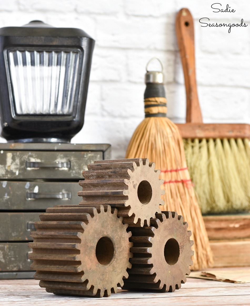 Vintage vignette of industrial decor with factory molds and old brushes