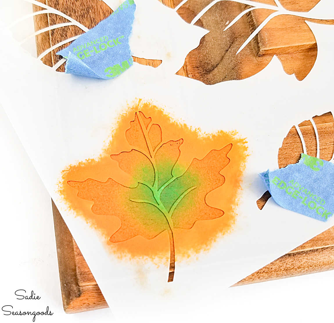 painting fall leaves on an autumn sign