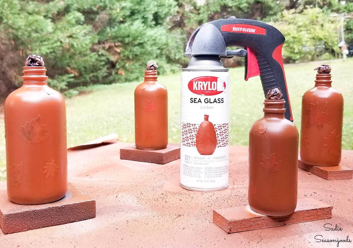 amber glass spray paint on bottles