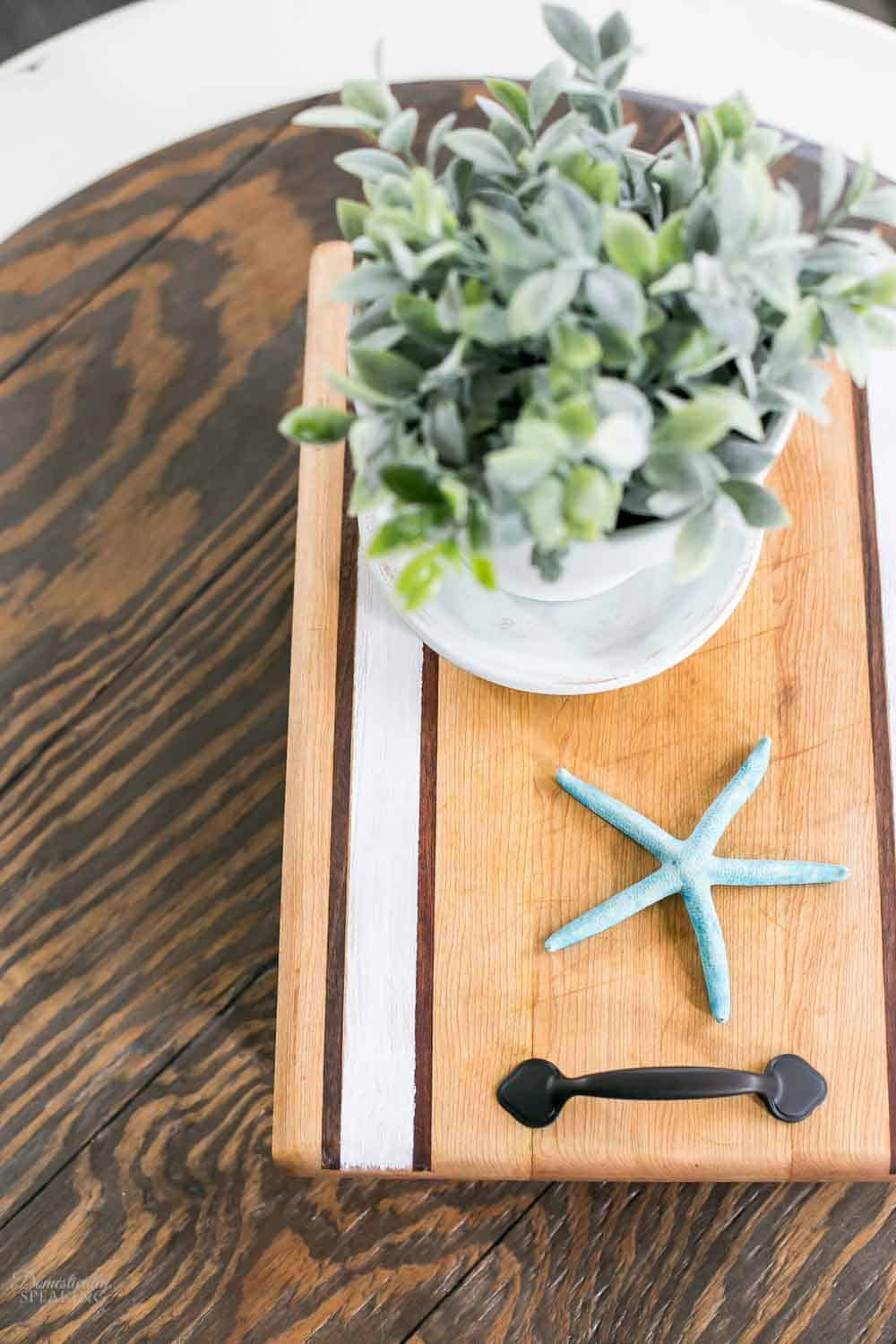 Painting a cutting board from the thrift store and upcycling it into a tray