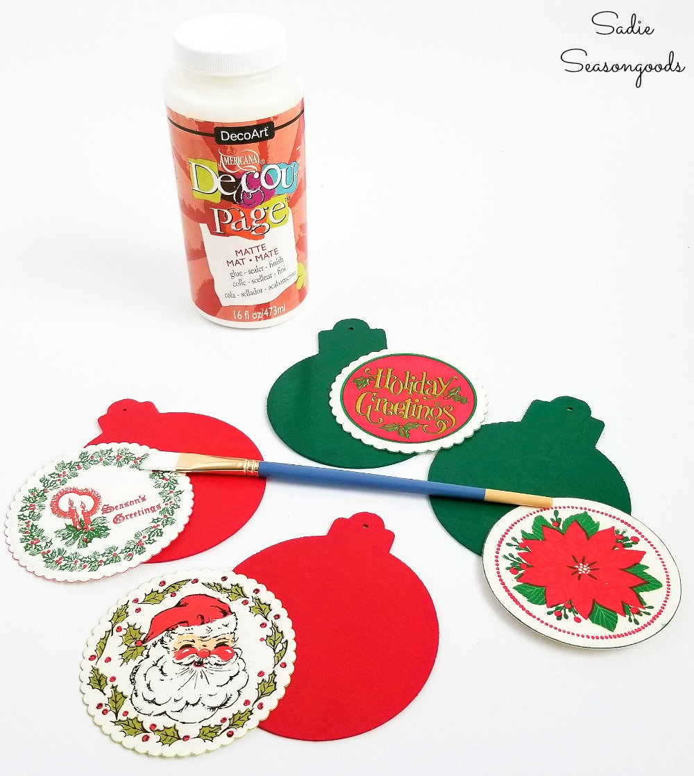 Decoupage glue to attach the paper coasters to the wood ornaments or wood cutouts