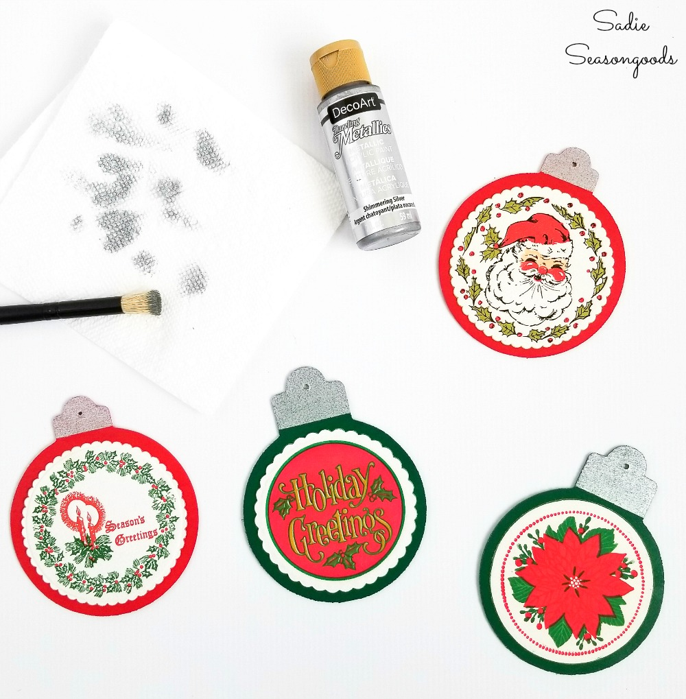 Painting the ornament caps with silver craft paint to look like retro Christmas ornaments