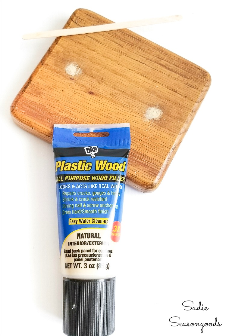 Filling in the screw holes on a wooden canister with Plastic Wood or wood filler