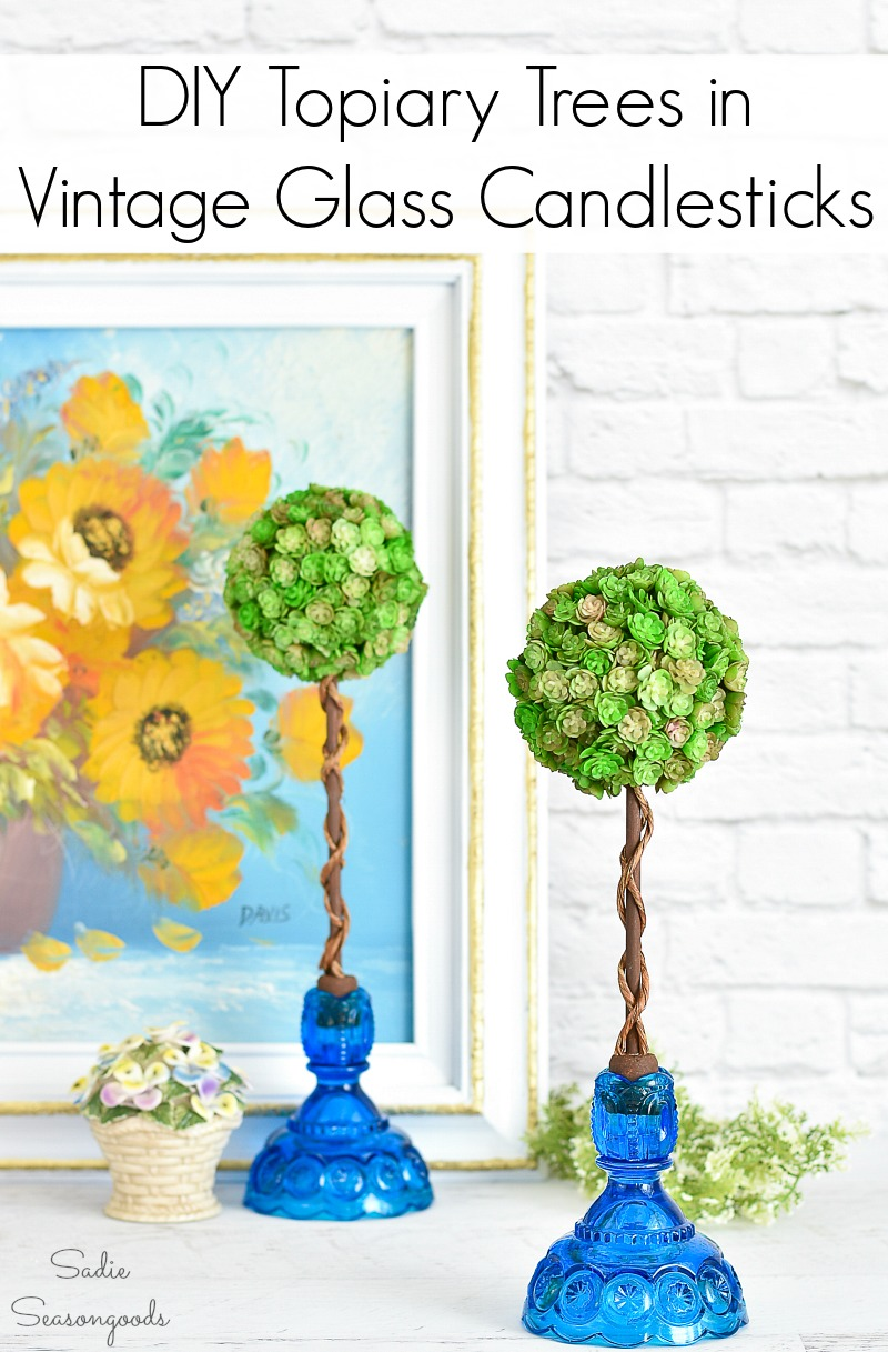 Spring mantel decor with artificial topiary trees in vintage candlesticks
