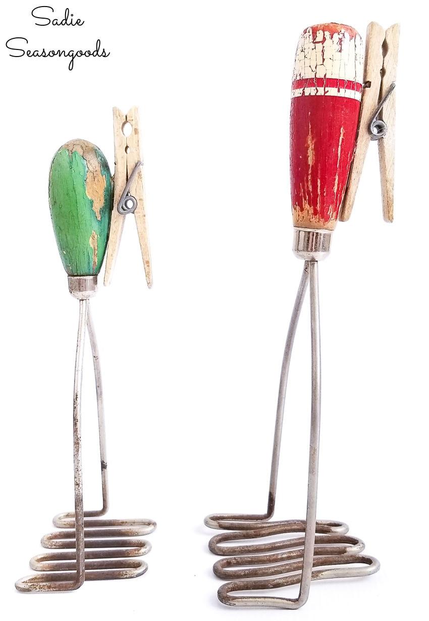 vintage kitchen utensils as a recipe stand
