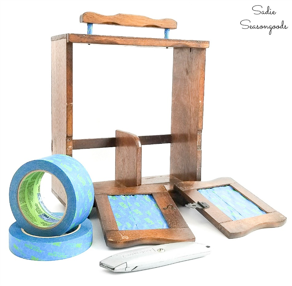 Preparing a wooden caddy for spray painting with painter's tape