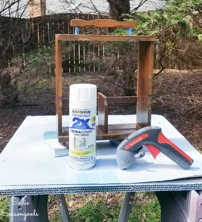 Spray painting a wooden caddy for liquor decanters