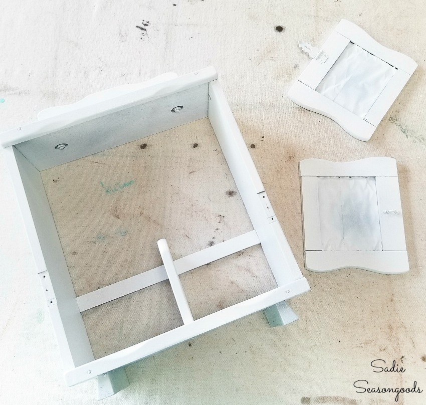 White spray paint on a wooden caddy for upcycling ideas