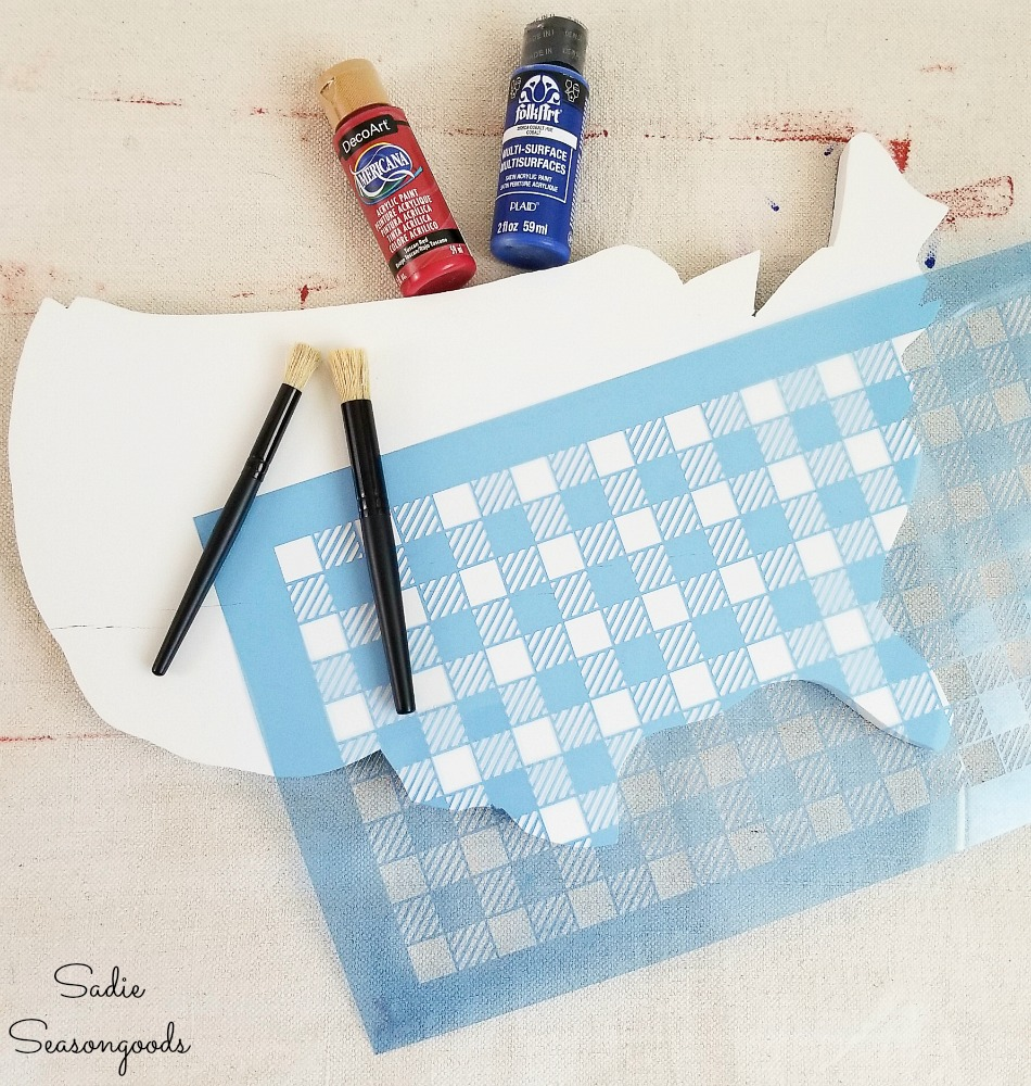 Using a buffalo plaid stencil to create the flag decor