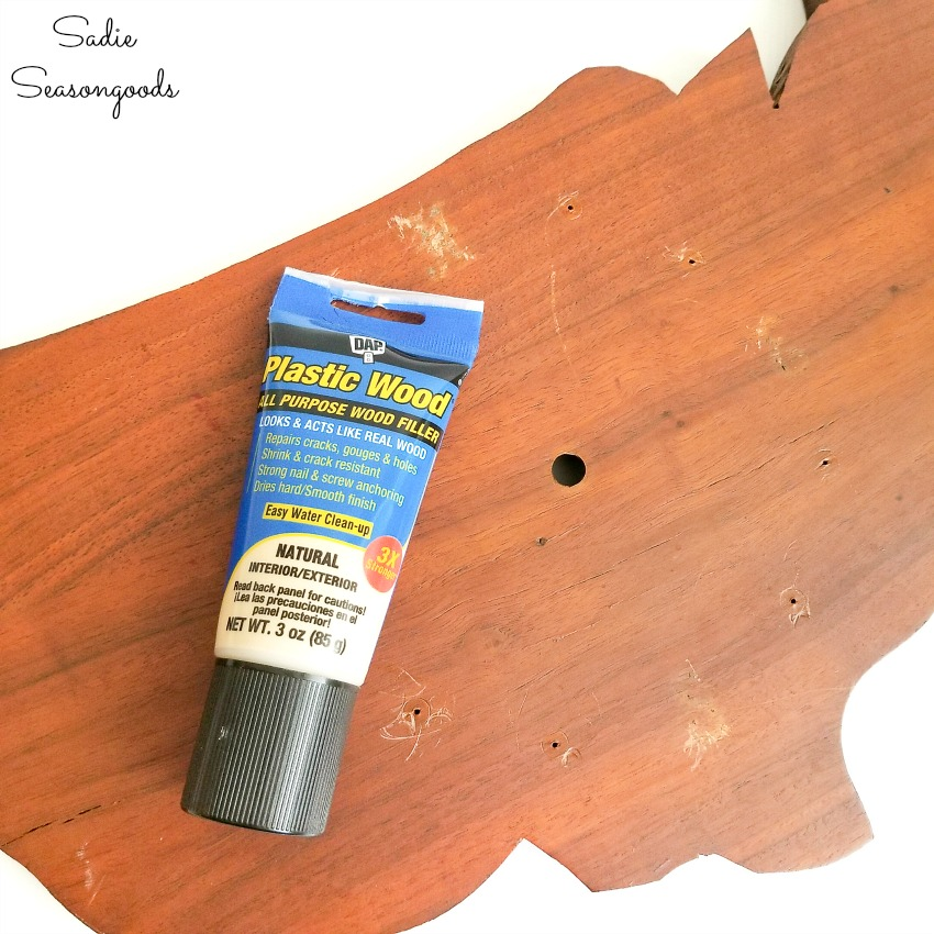 Wood filler or wood putty to fill in the holes before sanding
