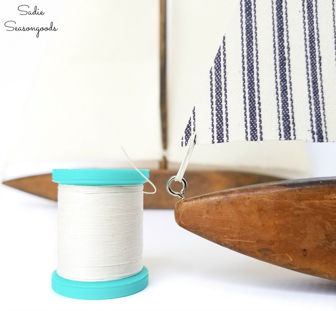 Craft thread to tie the sails to the decorative sailboats