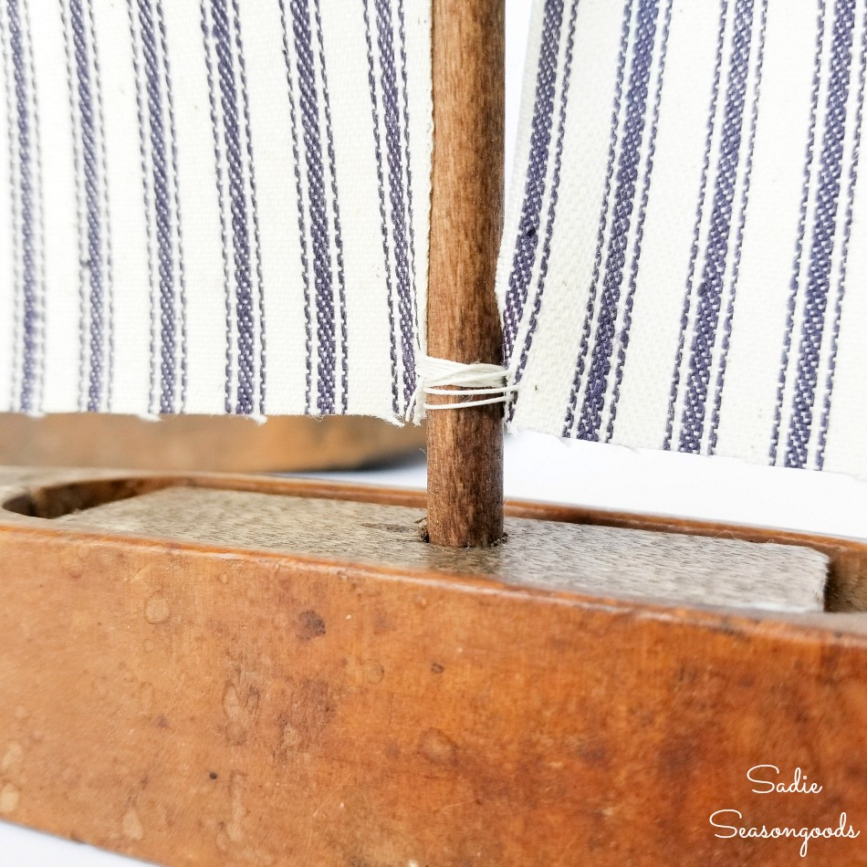 Upcycling a loom shuttle as sailboat decor