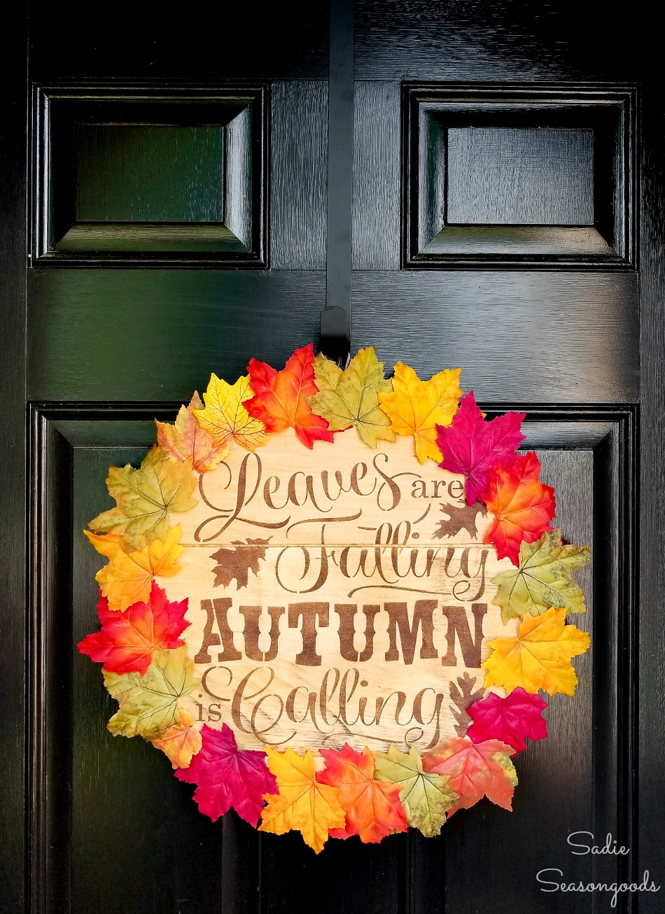 Lid of a wood cheese box as a fall door wreath