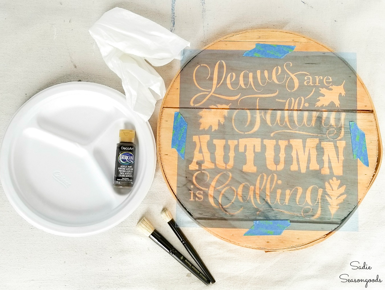 Stenciling with brown paint to look like a wood burned sign