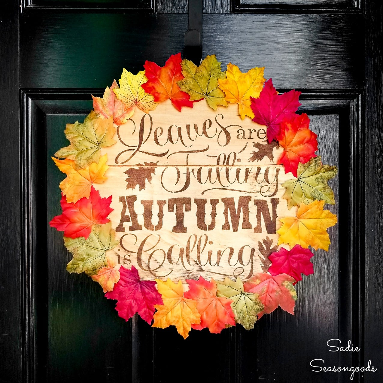 fall door wreath with the lid of a wood cheese box