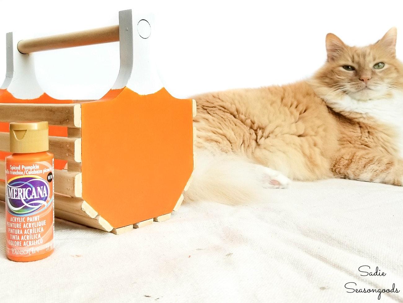 painting a pumpkin basket