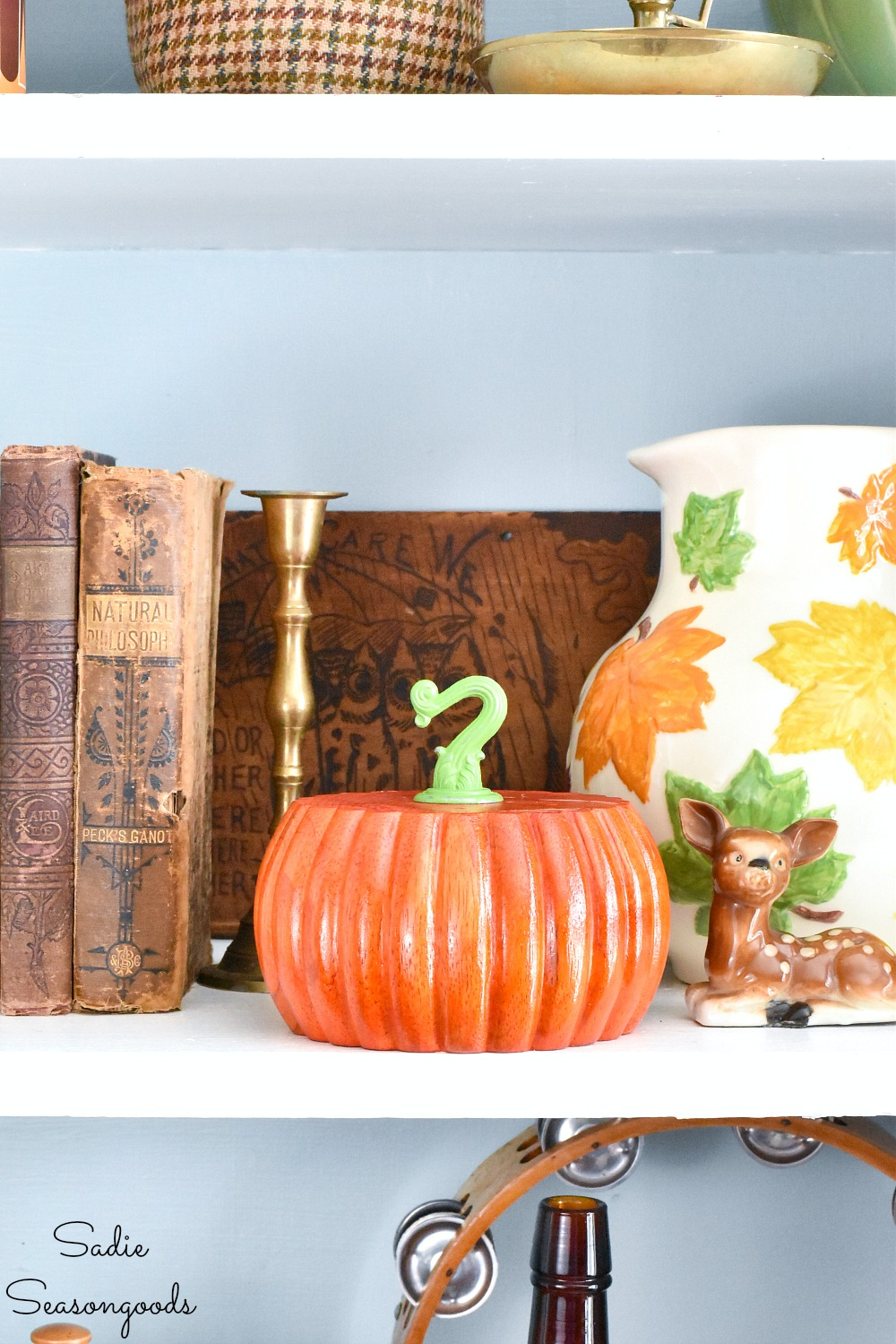 Decorating for autumn with bun feet as wood pumpkins