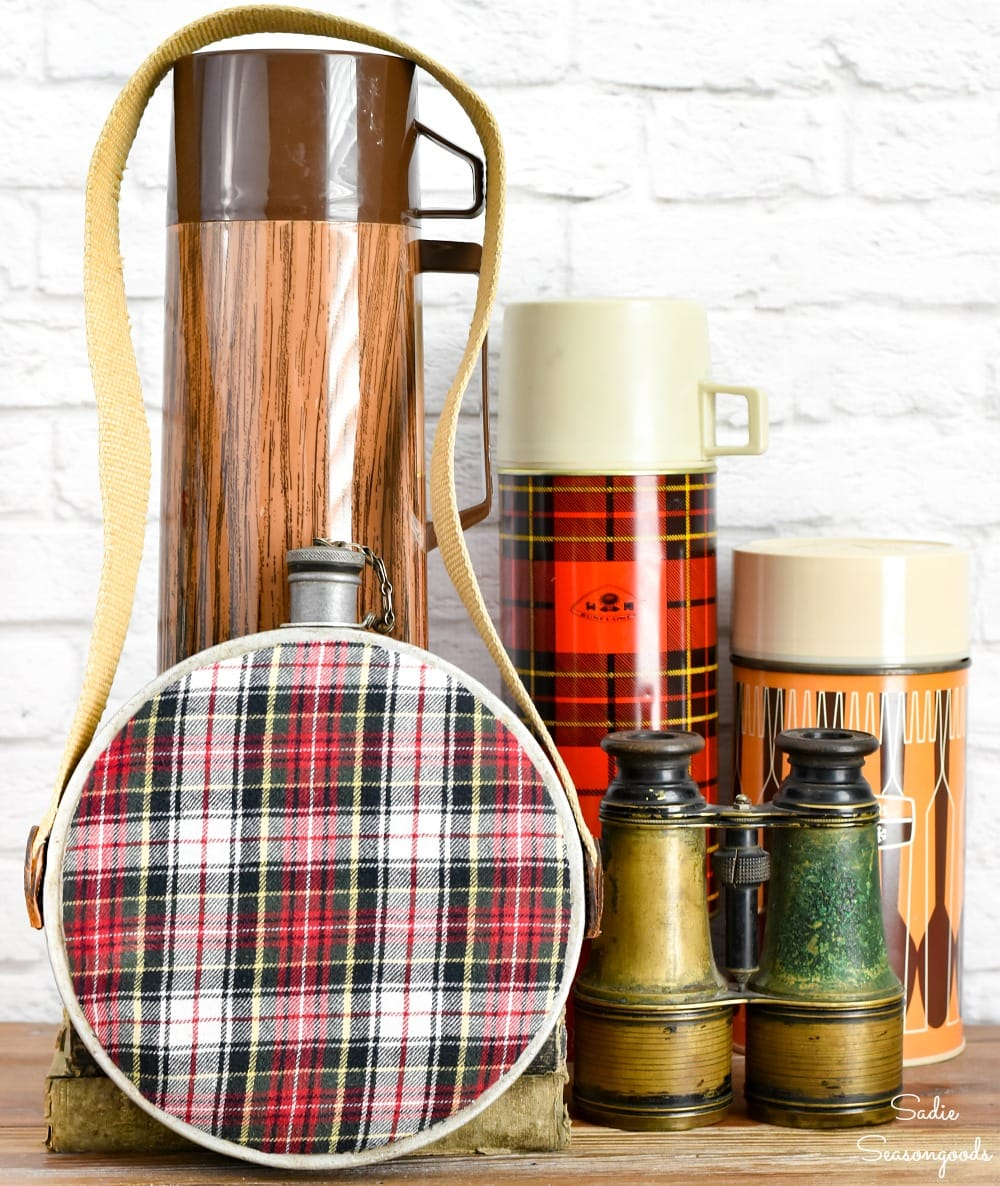 Mountain cabin decor with a metal canteen and flannel crafts