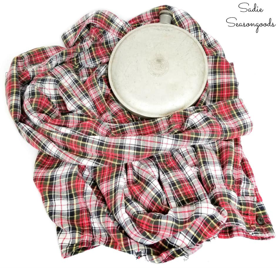 Upcycling a vintage canteen as plaid decor with a flannel shirt