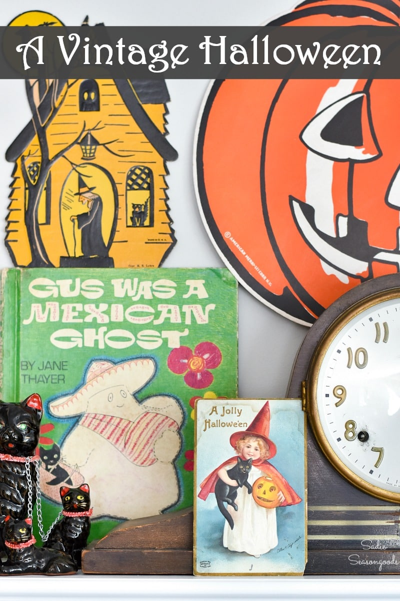 Decorating a Halloween mantel with vintage door hangers and postcards
