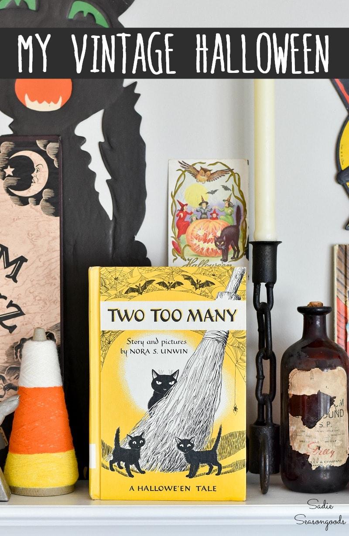 Halloween door hangers and Vintage Halloween postcards on a mantel