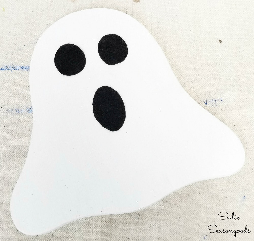 Halloween ghost decor from a vintage cheese board