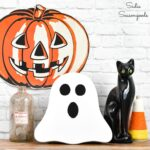 Halloween Ghost Decoration from a Wooden Cheese Board