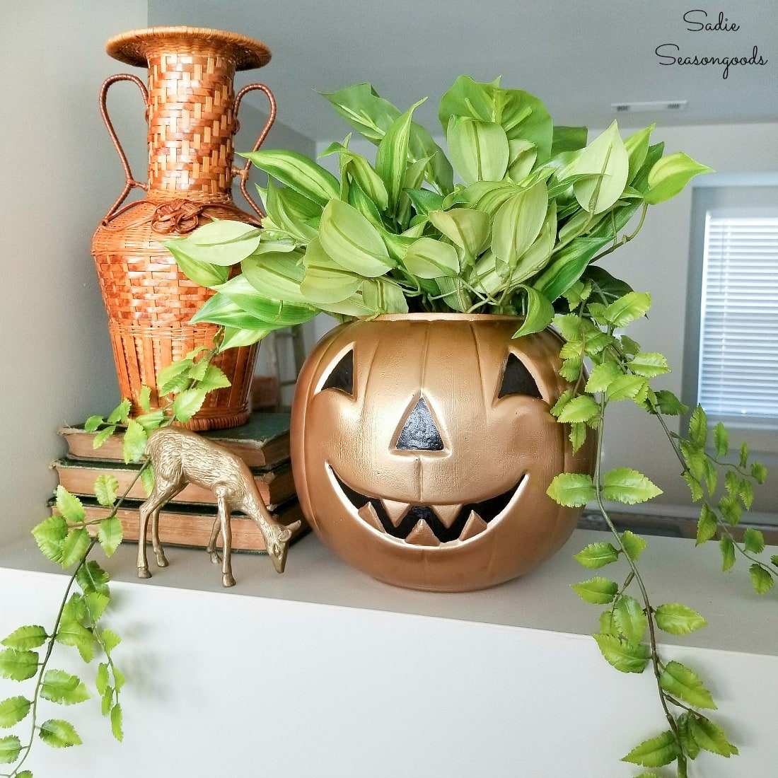 Upcycling a pumpkin candy bucket into modern Halloween decor