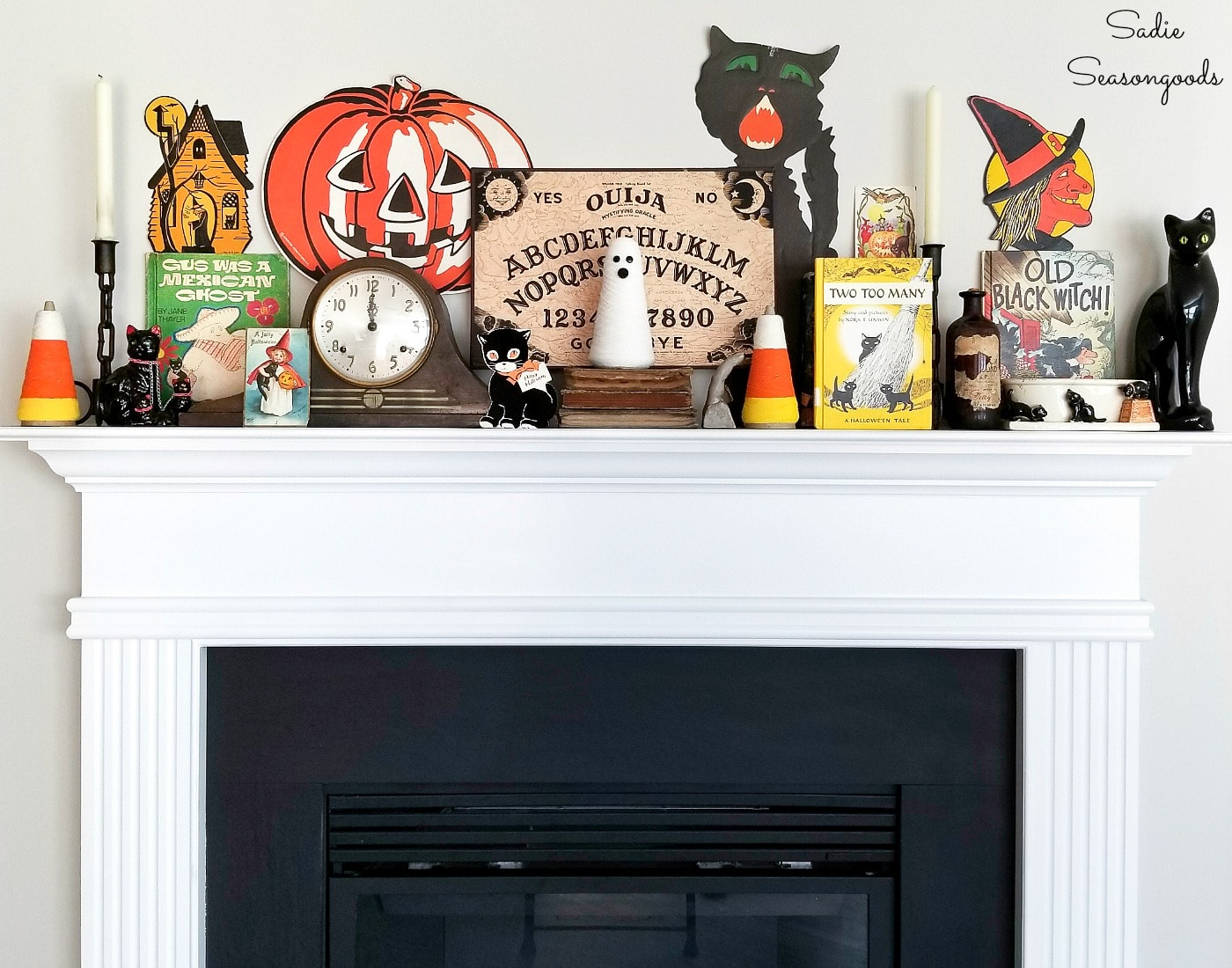 Vintage Halloween decor on a fireplace mantel